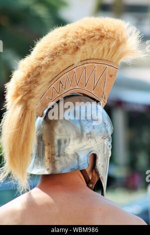 Rear View Of Shirtless Man Wearing Knight Helmet During Event - Stock Photo