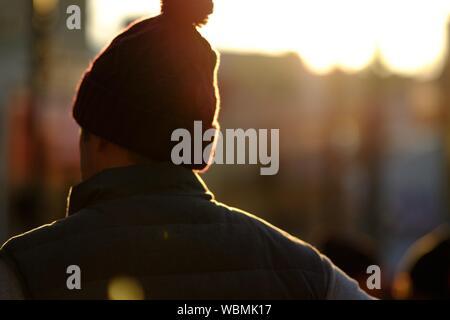 Rear View Of Man Wearing Cap - Stock Photo
