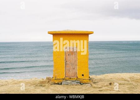 Close-up Of Yellow Hut On Beach Against Sky - Stock Photo