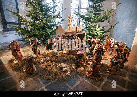 CHRISTMAS FAIR Lübeck Germany Nativity scene in church - Stock Photo