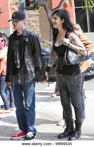 West Hollywood, CA - Lovebirds Kat Von D and Deadmau5 matched their dark colors as we spotted the couple arriving at Hugo's restaurant for lunch. Electronic music star Deadmau5 popped the question last December, using his Twitter account: 'I can't wait for Christmas so ... Katherine Von Drachenberg, will you marry me?', he also included a photo of a diamond ring with the disclaimer, 'Changing the diamond to black diamond FYI. Sorry for the jpg … they'll finish the actual ring soon I hope.' AKM-GSI March 3, 2013, - Stock Photo