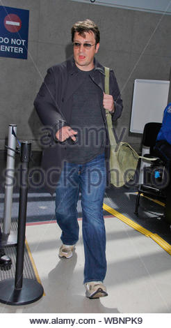 Los Angeles, CA - Canadian actor Nathan Fillion arrives at LAX, Nathan is currently starring as Richard Castle on the ABC series Castle. He is also known for his portrayal of the lead role of Captain Malcolm Reynolds in the television series Firefly and its feature film continuation, Serenity. AKM-GSI, March 10, 2013 - Stock Photo