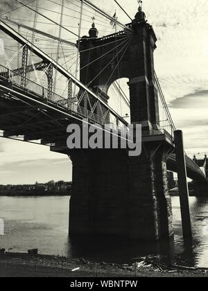 Low Angle View Of John A Roebling Suspension Bridge Over River Against Sky - Stock Photo