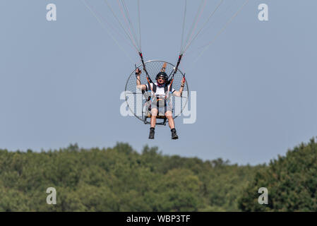 Powered paraglider, PPG, Paramotor pilot coming in to land at the Children in Need Little Gransden Air and Car Show. Space for copy - Stock Photo