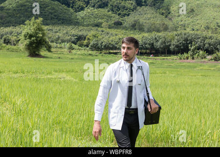 Full Length Of Doctor Walking On Field - Stock Photo