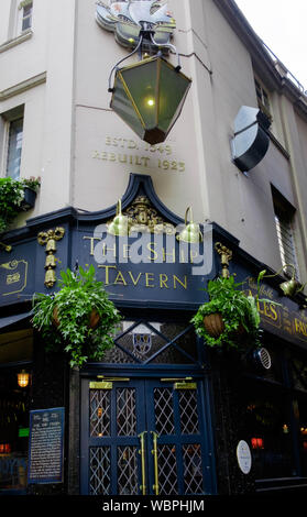 The Ship Tavern is a Mahogany-panelled 16th century pub with traditional real-ale bar and upstairs dining room located in a quiet corner of Holborn. - Stock Photo