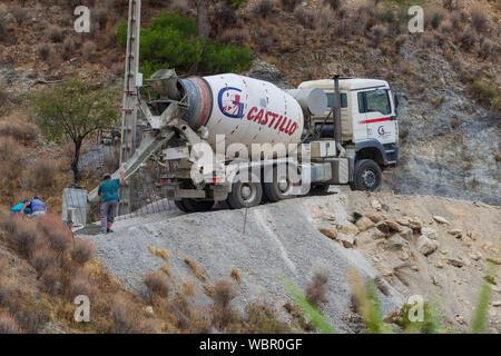 Cement Mixer Truck Delivering Concrete - Stock Photo