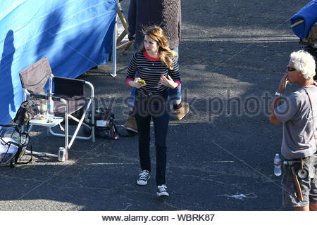 Malibu, CA - Emma Roberts takes a moment to reflect while she films on location for the FOX pilot, 'Delirium'. The 22-year-old actress instagrammed a picturesque Malibu beach photo with the caption, 'View from my trailer today', followed by another photo of a bloody pair of jeans with the caption, 'Wounded'. AKM-GSI, April 2, 2013 - Stock Photo