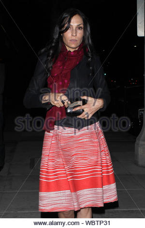 Beverly Hills, CA - Famke Janssen departs a sushi dinner at Matsuhisa in Beverly Hills. The 'Hemlock Grove' star looked stylish in a black jacket over a coral dress with white stripes, red scarf with pink polka dots and a pair of ruby red pumps. AKM-GSI, April 18, 2013 - Stock Photo