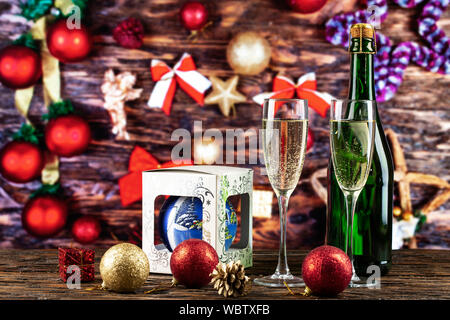 Christmas background with glasses. glasses with champagne on a wooden background with Christmas toys. christmas card - Stock Photo