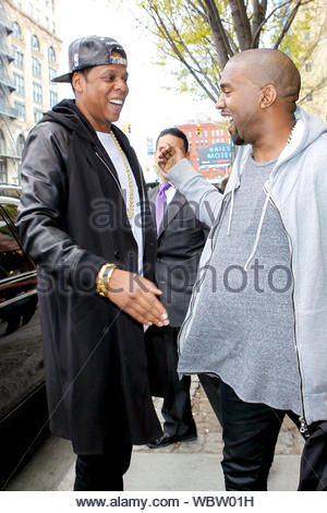 New York, NY - Jay-Z pays Kanye West a visit at his New York apartment, giving each other a warm bro-hug and a pat on the shoulder. HOV smiled as he greeted the father-to-be. Kanye, also in town at the same time as his girl Kim Kardashian, looked happy to see his Big Brother. AKM-GSI, April 22, 2013 - Stock Photo