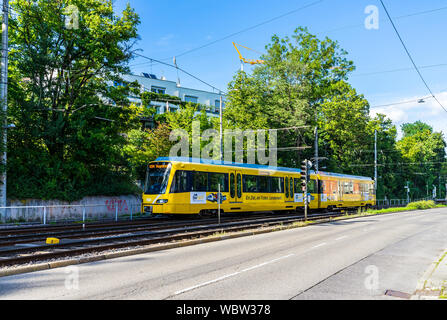Stuttgart, Germany, August 16, 2019, Yellow train of ssb line u34 to vogelsang driving from train station suedheimer platz transporting passengers eco - Stock Photo