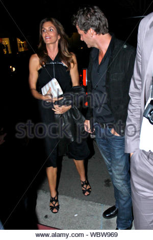West Hollywood, CA - Cindy Crawford and Randy Gerber attend a Marc Jacobs party honoring photographer Brian Bowan Smith, hosted by Emma Rossum at the Marc Jacobs Flagship in West Hollywood. AKM-GSI, April 26, 2013 - Stock Photo
