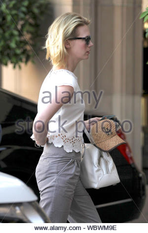 Beverly Hills, CA - January Jones keeps herself busy and takes care of business in Beverly Hills. The 'Mad Men' star dressed casual in a cream eyelet top, crop grey trousers, and matching grey oxford shoes. AKM-GSI, May 2, 2013 - Stock Photo