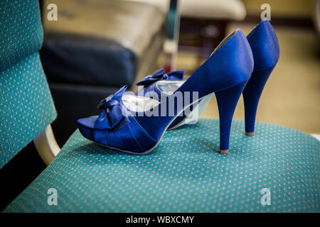 Close-up Of Blue High Heels On Chair - Stock Photo