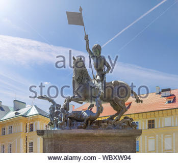 Prague, Czech Republic - July 7, 2018: The monument of St. George made of bronze is placed in front of the St. Vitus Cathedral in Prague Castle. It wa - Stock Photo
