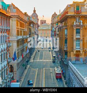 Genoa , Italy - July 4, 2019:  Via XX Settembre -- 20th September street and De Ferrari square in the end in Genoa in the evening - Stock Photo