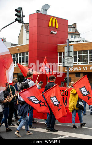 Demonstration of left-wing groups, red flags of communist parties, organizations, McDonalds restaurant, Wuppertal, Germany - Stock Photo