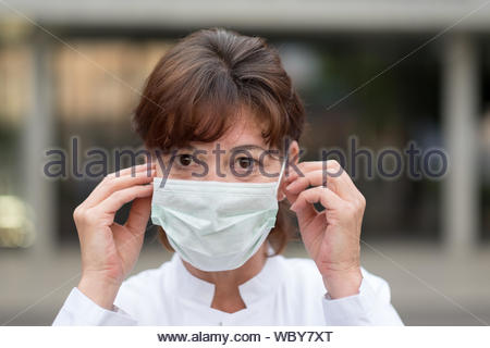 Portrait Of Woman Wearing Face Mask - Stock Photo