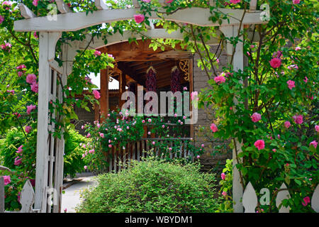 Historical Farmhouse Harden Arch and chili Ristra's - Stock Photo