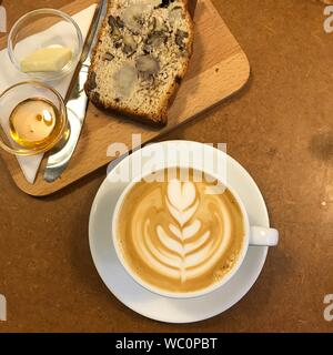 Directly Above Shot Of Coffee With Bread And Ingredients On Table - Stock Photo