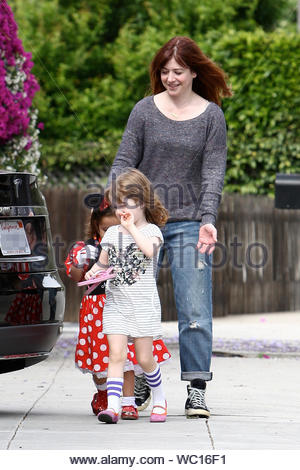 Brentwood, CA - Alyson Hannigan and her daughters Satyana and Keeva arrive for a play date at a friends house in Brentwood. Alyson looked cute in a pair of rolled up stressed blue jeans, black converse tennis shoes and a grey sweater. AKM-GSI, June 11, 2013 - Stock Photo