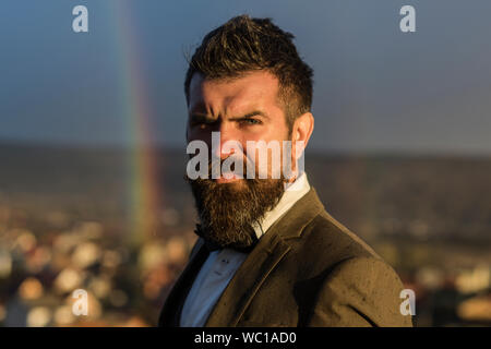 Guy with concentrated face in suit. Hipster with stylish hairdo - Stock Photo