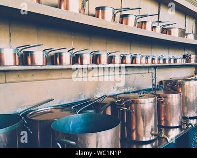 Copper Utensils Arranged On Shelf In Kitchen - Stock Photo