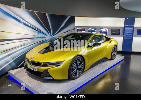 A BMW i8 Protonic Frozen Yellow Edition plug-in hybrid sports car on display in the BMW Museum, Munich, Bavaria, Germany. - Stock Photo