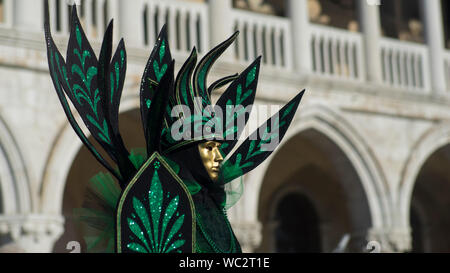 Person Wearing Costume And Mask During Carnival Of Venice - Stock Photo