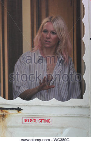 New York, NY - Naomi Watts get intense on the set of 'St. Vincent' filming in New York. Naomi shows off her red tipped blonde hair as she answers the door for a boy and gives him an evil look. AKM-GSI, July 21, 2013 - Stock Photo