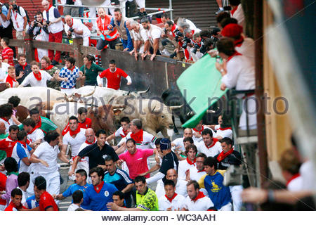Pamplona, Spain - A crowd of people run through the streets in Spain as participation of the fifth day of the Running of the Bulls during the annual San Fermin Festival. AKM-GSI, July 11, 2013 - Stock Photo