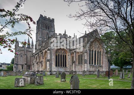 St Peter and St Pauls Church and its graveyard with tombs in Northleach town, Gloucestershire, Cotswolds, England - United Kingdom - Stock Photo