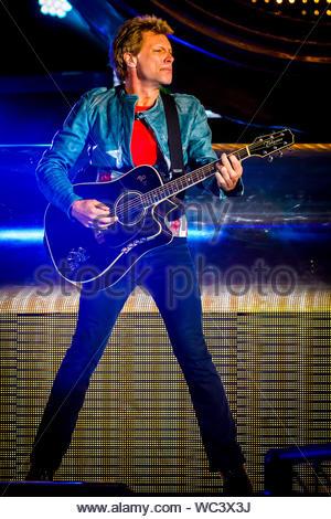 Jon Bon Jovi on stage at Ibrox playing guitar 1996 Stock ...