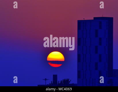 Sunset over city centre Manchester, United Kingdom, at the end of a hot August Bank Holiday weekend - Stock Photo