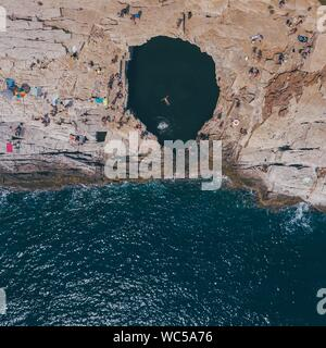 High Angle View Of Rock Formation Amidst Sea - Stock Photo