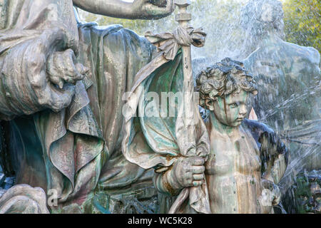 Child Sculpture of fountain from Place Des Quinconces in Bordeaux - Stock Photo