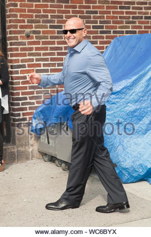 New York, NY - Dean Norris arrives at Ed Sullivan Theatre for his guest appearance on 'The Late Show with David Letterman'. The seasoned actor was on hand to discuss the new season of 'Breaking Bad', in which he plays the character Hank Schrader, Walt's DEA agent brother-in-law. AKM-GSI, August 19, 2013 - Stock Photo