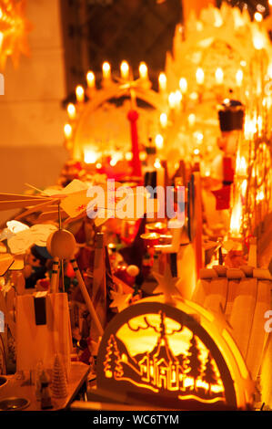 Illuminated Decorations For Sale At Market Stall During Christmas - Stock Photo