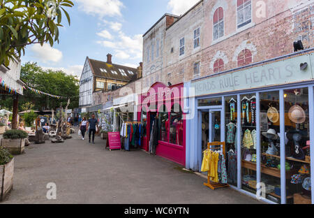 Small clothes and artisan shops and boutiques in Gabriel's Wharf in Southwark, London SE1 on the South Bank of the Embankment of the River Thames - Stock Photo