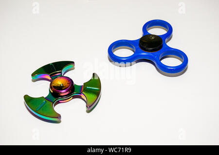 High Angle View Of Colorful Fidget Spinners On White Background - Stock Photo