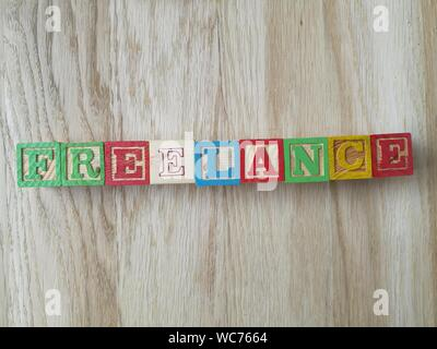 Directly Above Shot Of Freelance Text Made From Toy Blocks - Stock Photo