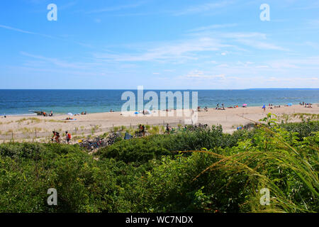 People relaxing and sunbathing at the Fort Tilden beach on a hot summer afternoon on August 11th, 2019 in Queens, New York, USA. (Photo by Wojciech Mi - Stock Photo