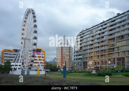 Ferris wheel 'The View' located in Rotterdam town centre, the Netherlands. The temporary big wheel is located close to the Markthal. - Stock Photo