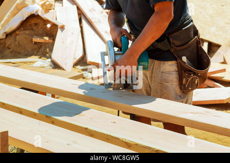 Midsection Of Man Working At Construction Site - Stock Photo