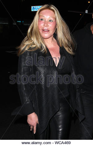 West Hollywood, CA - Jocelyn Wildenstein and her boyfriend, fashion designer Lloyd Klein depart a dinner date at BOA Steakhouse in West Hollywood Sunday night. The 73-year-old socialite is often called, 'Cat Woman' in reference to the extreme plastic surgeries that she has undergone over the years. AKM-GSI, September 29, 2013 - Stock Photo