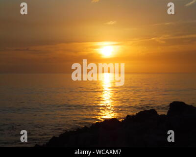 Scenic View Of Sun Reflecting On Sea During Sunset - Stock Photo