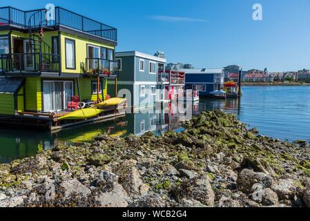 Colorful houseboats at Fisherman's Wharf in Victoria, BC. - Stock Photo