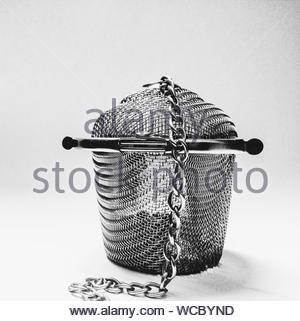 Metal Wire Mesh Basket Cage With Chain Attached - Stock Photo