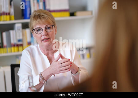 Hanover, Germany. 22nd Aug, 2019. Cathrin Burs, new president of the Chamber of Pharmacists of Lower Saxony, speaks during an interview. In Lower Saxony, the number of pharmacies has fallen by more than 10 percent since 2009 to currently 1892. When rural doctors' practices close, local pharmacists often do not find a successor either. The new president of the Chamber of Pharmacists of Lower Saxony, Cathrin Burs, hopes for impulses from the Pharmacy Strengthening Act planned at federal level. Credit: Ole Spata/dpa/Alamy Live News - Stock Photo